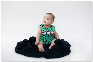 Baby boy, navy blue, green, sitting