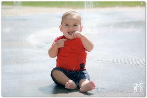 1 year, boy, splash pad, happy, fun, red